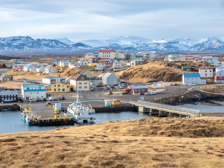 Commercial harbor with ships and boats in bays with cityscape view at Stykkisholmur town in Iceland