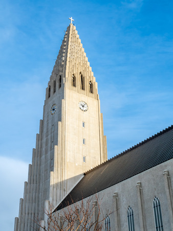 Hallgrimskirkja church, the most famous landmark place of Iceland, under cloudy morning blue sky in winter season, Reykjavik, Iceland Stock fotó