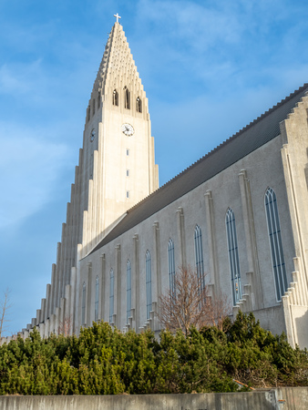 Hallgrimskirkja church, the most famous landmark place of Iceland, under cloudy morning blue sky in winter season, Reykjavik, Iceland Stock Photo