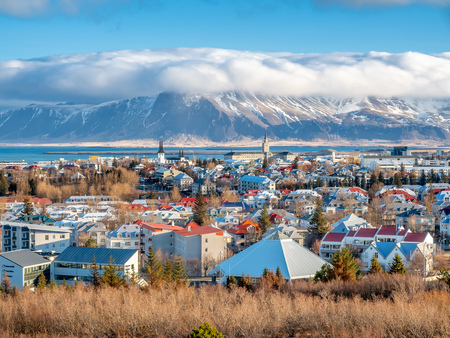 Cityscape of Reykjavik, capital city of Iceland, under cloudy blue sky from Perlan Observatory deck viewpoint
