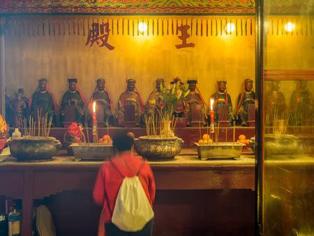 HONG KONG, CHINA - JANUARY 20 : Man Mo temple with full of incense smoke from respect people, landmark at central district of Hong Kong, China, on January 20, 2018.
