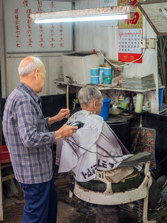 HONG KONG, CHINA - JANUARY 20 : Old fashion style of barber shop in Chinese vintage in Hong Kong, China, was taken on January 20, 2018.