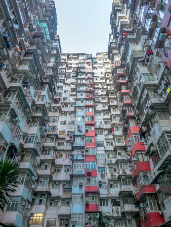 HONG KONG, CHINA - JANUARY 20 : Yik Cheong Building or Monster buildings, location in many blockbuster Hollywood movies, is one of the most popular landmark in Hong Kong, China, was taken on January 20, 2018.