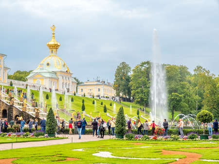 PETERHOF, RUSSIA - SEPTEMBER 1 : View of Grand Cascade palace and surrounding fountains in summer season of Peterhof palace in Russia under cloudy sky, on September 1 2018.