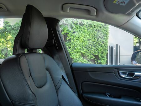 BANGKOK, THAILAND - JANUARY 1 : Genuine leather black color passenger seat with headrest in Bangkok, Thailand, on January 1, 2019. 스톡 콘텐츠 - 136920620