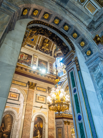 SAINT PETERSBURG, RUSSIA - SEPTEMBER 4, 2018 : Sophisticated interior architecture of St. Isaac's Cathedral, altar, dome, painting, sculpture, art, in Saint Petersburg, Russia