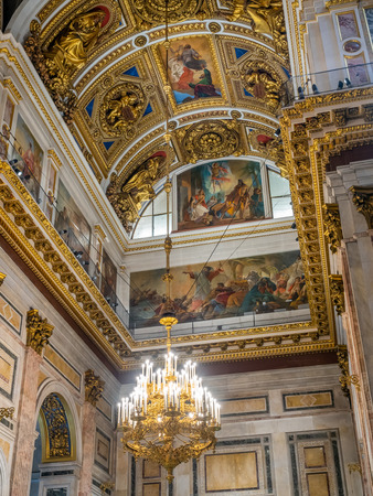 SAINT PETERSBURG, RUSSIA - SEPTEMBER 4, 2018 : Sophisticated interior architecture of St. Isaacs Cathedral, altar, dome, painting, sculpture, art, in Saint Petersburg, Russia Editorial