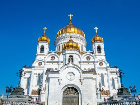 Cathedral of Christ the Saviour, the second tallest Orthodox church in the world, landmark of Moscow, Russia, under blue sky in summer season 스톡 콘텐츠 - 131840402