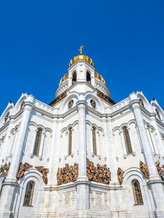 Cathedral of Christ the Saviour, the second tallest Orthodox church in the world, landmark of Moscow, Russia, under blue sky in summer season 스톡 콘텐츠 - 131838312