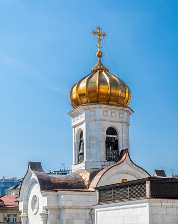 Golden small dome of Cathedral of Christ the Saviour, the second tallest Orthodox church in the world, landmark of Moscow, Russia, under blue sky in summer season 스톡 콘텐츠 - 130821064