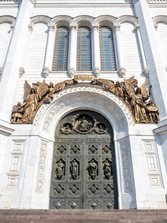 Door arch decoration with angel sculptures at Cathedral of Christ the Saviour, landmark of Moscow, Russia, under blue sky in summer season 에디토리얼