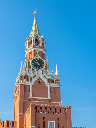 Spasskaya clock tower at wall of Kremlin, exit to Red Square in Moscow, Russia 스톡 콘텐츠 - 131367240