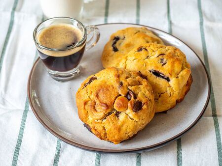 Chunky chewy chocolate chip soft cookies with cup of hot coffee for breakfast, selective focus on melting chocolate chips 스톡 콘텐츠 - 148367713
