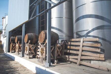 Modern  storage technology agro-industry, metal containers for grain business  granary trail perspective . Grain-drying Complex, Commercial  Seed Silos , wood brown barrels wine.