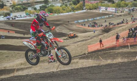 MX moto cross racing - Girl Bike Rider riding on dirt track - extreme jump. Extreme Motocross.