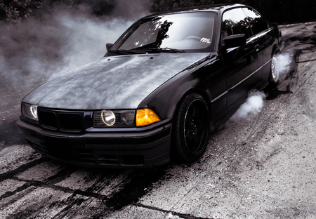 Moldova 09252019. Sport modern Stance Car racing car drifting with smoke drift burnout, big colorful green blue clouds with clean wheels and burning tires. Extreme street stunts. Redactioneel