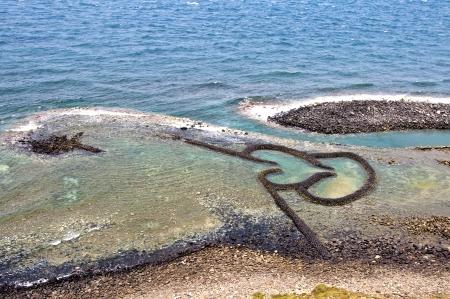 Taiwan Landmark Twin Hearts Stone Tidal Weir in Chimei Taiwan scenery  写真素材