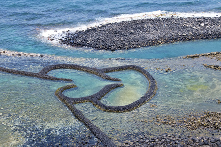 Taiwan Attractions Twin Hearts Stone Tidal Weir 스톡 콘텐츠