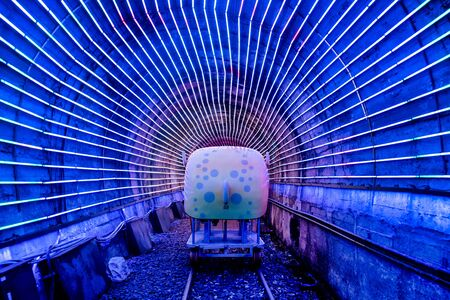 Four-wheeled bicycles on abandoned train tracks, inside the light tunnel. Its a popular place to relax, in Badouzi, Keelung, Taiwan. August 21, 2019