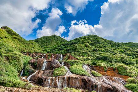 Golden Waterfall - Famous nature landscape of Jinguashi, shot in in Ruifang District, New Taipei City, Taiwan. Stock Photo