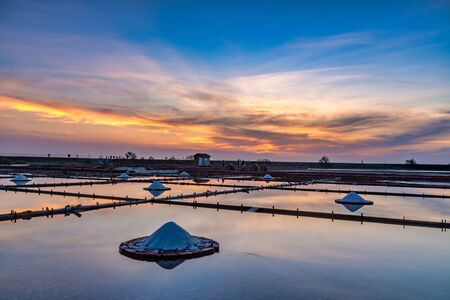 Picturesque place at sunset,Jing Zhai Jiao Tile- Paved Salt Fields in Tainan, Taiwan Stock Photo