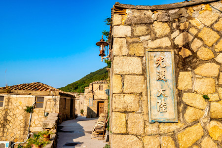 The historical Qinbi Village at Matsu, Taiwan.Writing Chinese(Military slogan) on the wall: Restoration continent Publikacyjne