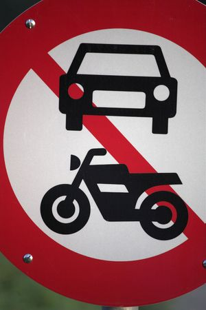 traffic  signs in a city; forbidden to motorcycles    close up of old collection vintage cars   photo