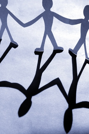 small rudimentary figures of man in paper Stock Photo - 9408950