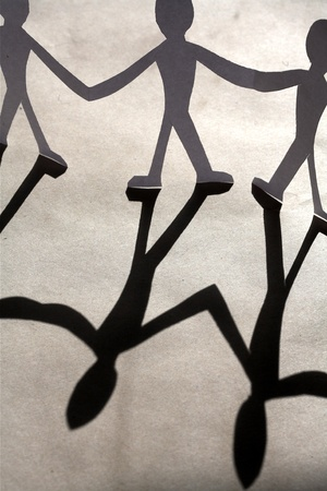 small rudimentary figures of man in paper Stock Photo - 9401336