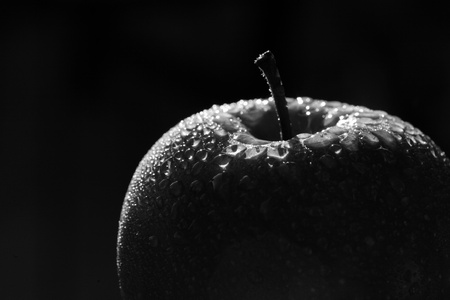 close up picture of a green apple, black and white version Stock Photo