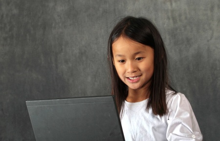 young child - girl- with computer keyboard photo