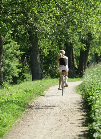 girl on bike on a forest path in denmark Stock Photo - 9489909