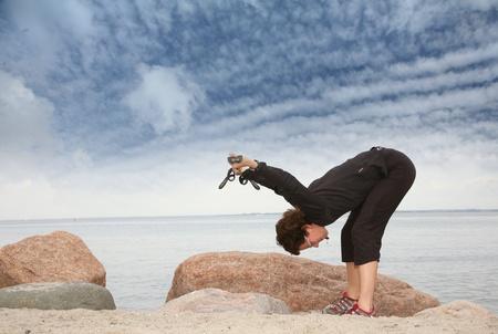 woman training nordic walking on a beach in denmark Stock Photo - 10071016