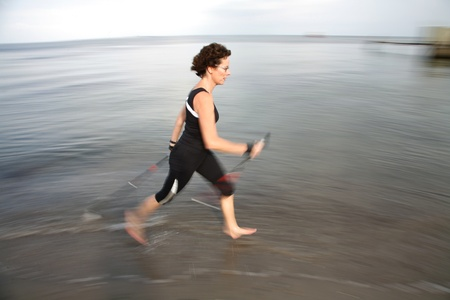 woman training nordic walking on a beach in denmark Stock Photo - 10071014
