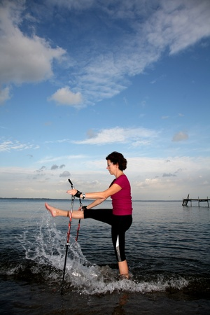 woman training nordic walking on a beach in denmark Stock Photo - 10071021