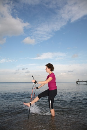 woman training nordic walking on a beach in denmark Stock Photo - 10071015
