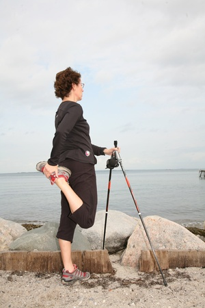woman training nordic walking on a beach in denmark Stock Photo - 10071022