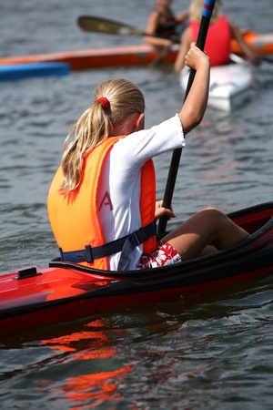 a lake in denmark with young people on kayak Stock Photo - 9495819