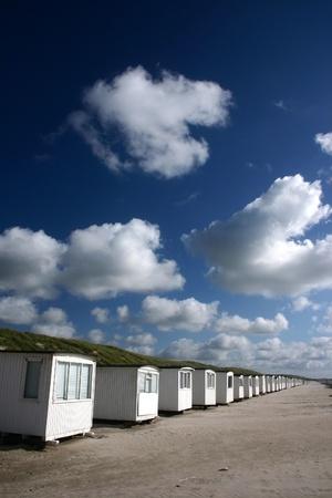 summer in denmark: beach of loekken, beach houses in line Stock Photo - 9586616
