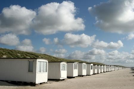 summer in denmark: beach of loekken, beach houses in line photo