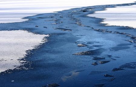 horison: a frozen lake in denmark in winter