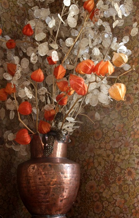 red and white dried  flowers in a vase in copper  photo
