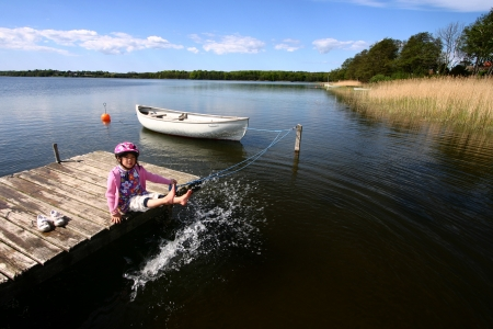 rowboats: a lake in denmark