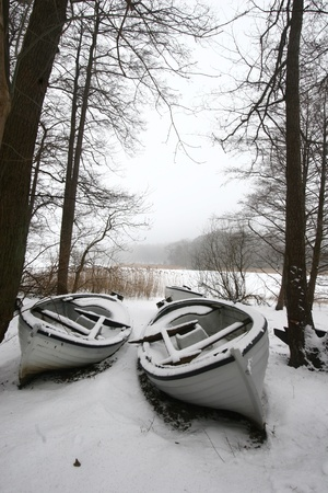 boat on iced  lake in denmark in winter Stock Photo - 9742208