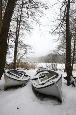 boat on iced  lake in denmark in winter Stock Photo - 9742208