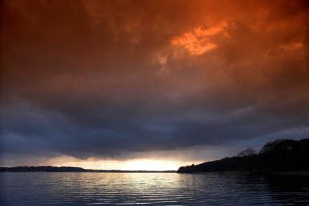 horison: Reflections on a lake in denmark in winter