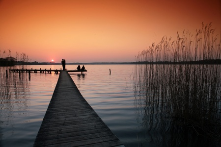 countryside loving: a lake in denmark , a so called bath bridge on a danish lake at the sunset Stock Photo