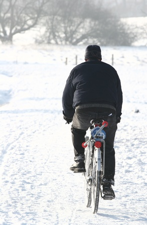 man on bike on an icedroad  in  denmark Stock Photo - 9742341