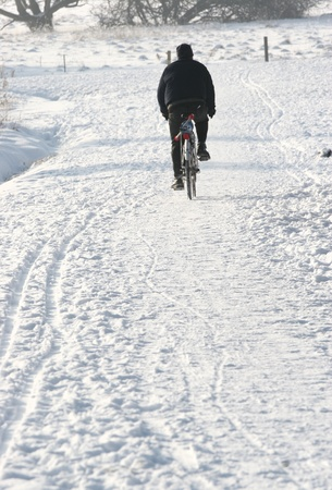 man on bike on an icedroad  in  denmark Stock Photo - 9742355
