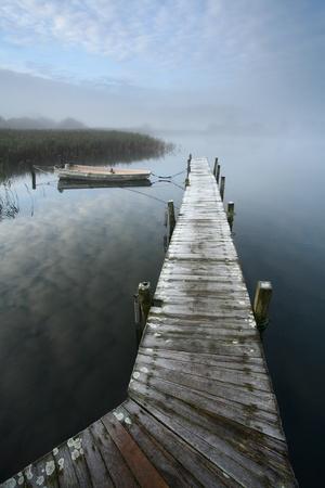 A lake in denmark , a so called bath bridge with fog and nice sky photo